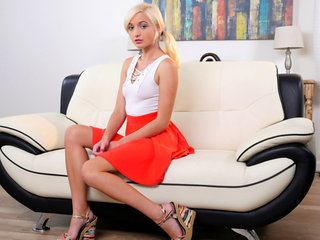 A miniskirt shows off Eliza Jane's long legs,..